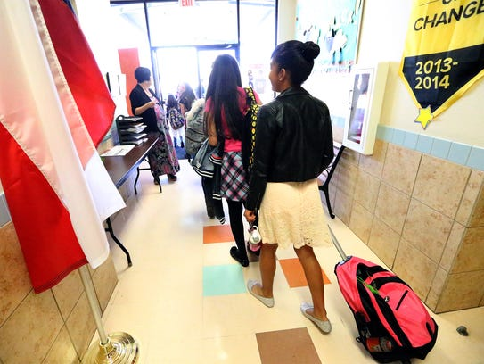 Students file out the door at the end of the school