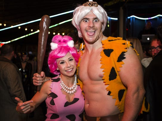 Dana Gallagher and Christian Tasker of Wilmington attend the Halloween Loop in 2014.