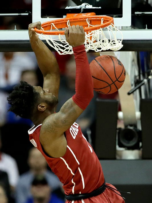 Oklahoma's Rashard Odomes dunks the ball during the first half of an NCAA college basketball game against TCU in the Big 12 Conference tournament Wednesday, March 8, 2017 in Kansas City, Mo. (AP Photo/Charlie Riedel)