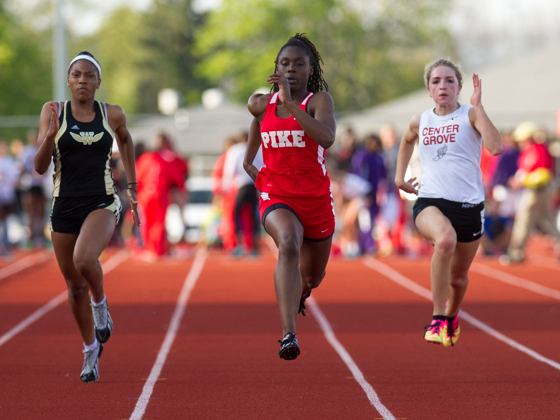 Pike High School senior Lynna Irby competes in the first heat of the 100 Meter Dash. Pike High School hosted the Metropolitan Interscholastic Conference (MIC) boys and girls track meet Friday, May 1, 2015.