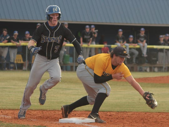Trenton Peabody's Matthew Pickard (8) grabs the ball to get Huntingdon's Kolton McMinn (7) out at first.