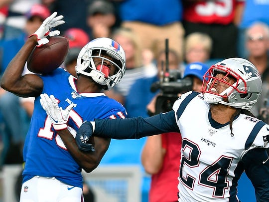 Buffalo Bills wide receiver John Brown catches a pass in front of New England's Stephon Gilmore.