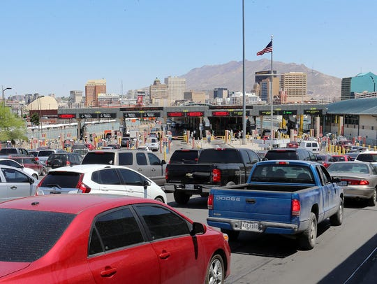Motorists on Tuesday wait to cross the Paso del Norte