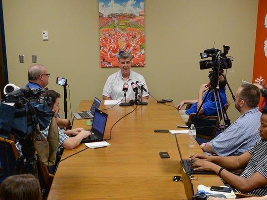 Clemson Athletic Director Dan Radakovich talks to media