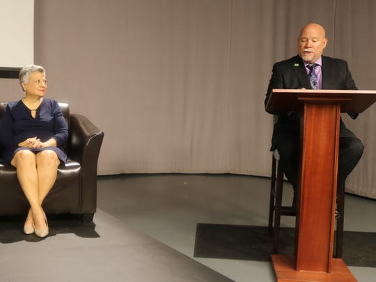 Ken Massey poses a question to panelist Frances Brown