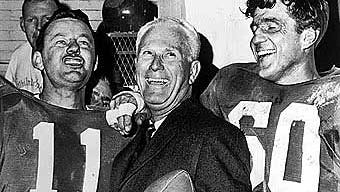 Before winning the 1960 NFL championship with the Eagles, shown above, Buck Shaw, center, was Nevada's head football coach.