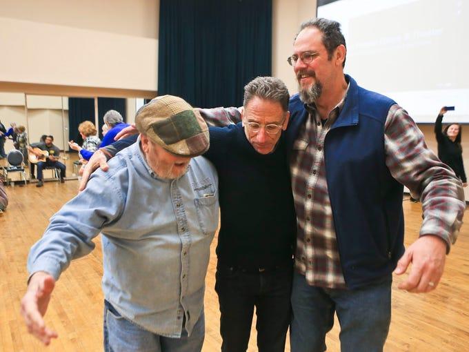 Stuart Pimsler, center, dances with musicians John