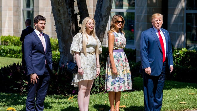 President Donald Trump, right, attends Easter services with first lady Melania Trump, second from right; his daughter, Tiffany; and her boyfriend, Michael Boulos, at The Episcopal Church of Bethesda-by-the-Sea in April.