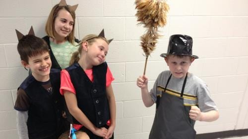 """North Pointe Elementary's Purple Cast energetically gears up to perform Disney's """"Aristocats."""" Production dates are April 30 through May 2. From left are Dawson Benjamin (Berloiz), Katie Slansky (Duchess), Anna Lighthall (bottom, Marie), Sydney Noble (Toulouse) and Ty Graft (Edgar)."""