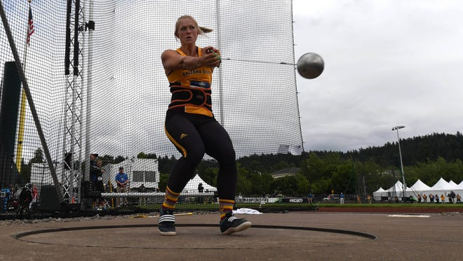 Maggie Ewen of Arizona State throws a collegiate and meet record of 240-7 (73.72m) in the women's hammer during the NCAA Track and Field Championships at Hayward Field.
