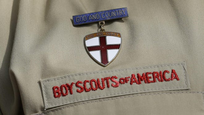 FILE - This Feb. 4, 2013 file photo shows a close up of a Boy Scout uniform badge during a news conference in front of the Boy Scouts of America headquarters in Irving, Texas. A team of lawyers filed a lawsuit on Monday, Jan. 6, 2020, in federal court in Washington, D.C., seeking to establish the nation's capital as a venue for men across the U.S. to sue the Boy Scouts of America for allegedly failing to protect them from long-ago sexual abuse at the hands of scoutmasters and other scout leaders.