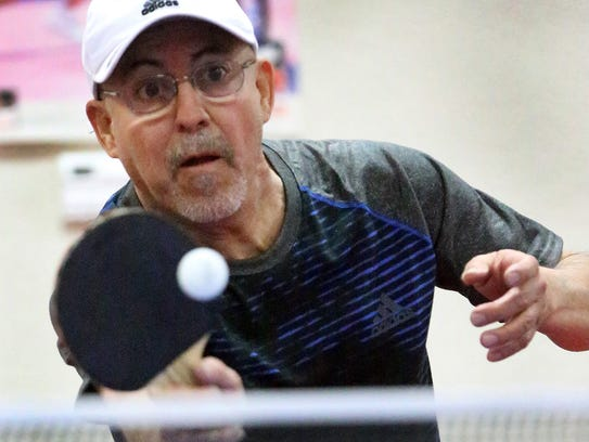 Raul Contreras returns a volley to opponent Tom Marsden