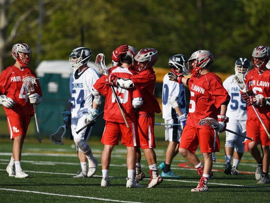 Boys lacrosse game between Fair Lawn and Paramus on Wednesday May 17, 2017. Joe Covino FL #4 tied the school SINGLE SEASON record with 77 goals and broke the record with 107 points. Fair Lawn celebrates after they score.