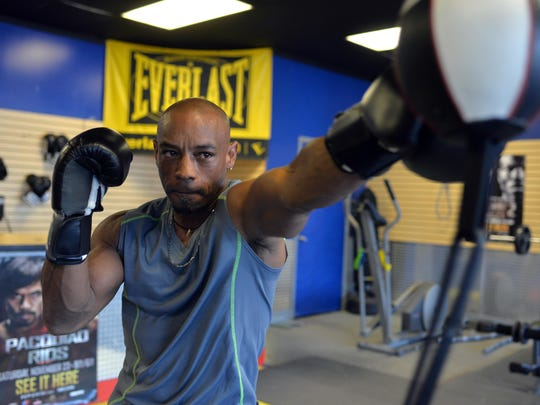 Vila Boxing owner David Anthony works with a striking