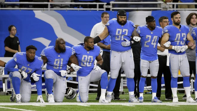 "Detroit Lions players take a knee during the national anthem before an NFL football game against the Atlanta Falcons in Detroit on Sept.24. Duane Burleson/AP FILE- In a file photo from Sept. 24, 2017, Detroit Lions defensive end Armonty Bryant (97), defensive tackle A'Shawn Robinson (91) and defensive end Cornelius Washington (90) take a knee during the national anthem before an NFL football game against the Atlanta Falcons, in Detroit. The sight of football players kneeling during the national anthem across the United States is the continuation of a tradition nearly as old the song itself. University of Michigan musicology professor Mark Clague says ""The Star-Spangled Banner"" has been a channel for protest since at least the 1840s. The lyrics were recast as an anti-slavery song and it's been used or reworked to push for racial equality, women's suffrage, prohibition and labor rights. (AP Photo/Duane Burleson, File)"