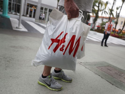 Clothing Retailer H&M logo bag