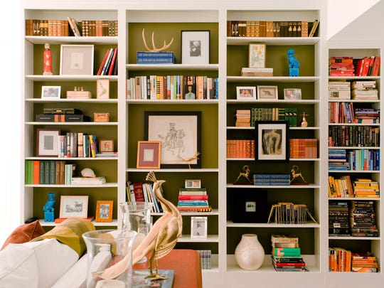 In this photo provided by M. Design Interiors, framed art is displayed both in and on a built-in bookcase. The effect is open and airy, while still providing ample storage space for the homeowner's book collection. The interior and bookcase design is by Molly Luetkemeyer. (AP Photo/ M. Design Interiors, Justin Officer)