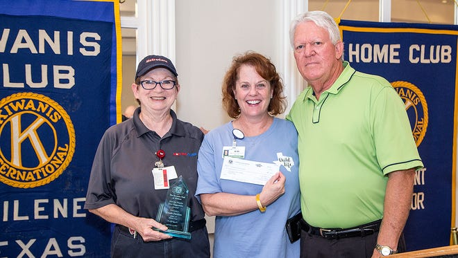 Melvin Martin (right) presents Mimi Schultz (center), of the Cook Children's Abilene clinic, with a $1,000 donation. The check was presented in honor of Linda Davison (left), who was the recipient of the Kiwanis Club of Abilene's 2017 Melvin Martin First Responder Award.