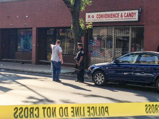 Police investigate the shooting of two men on East Third Street in Mount Vernon, Aug. 26, 2014.