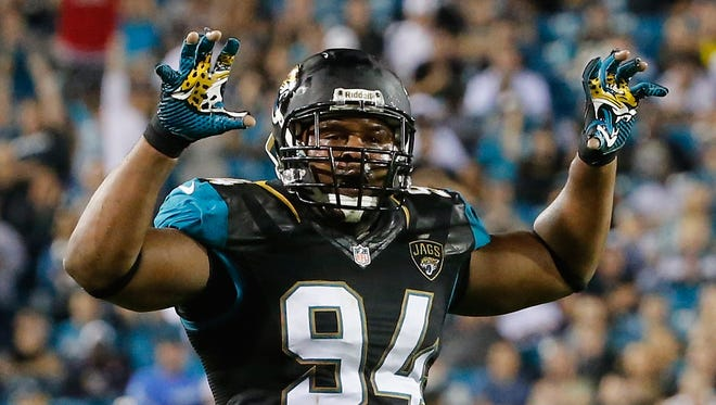 Jeremy Mincey of the Jacksonville Jaguars celebrates a defensive stand during the game against the Houston Texans at EverBank Field on December 5, 2013 in Jacksonville, Florida.