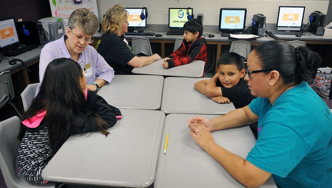 """A group of Scotland Park Elementary students meet with their Big Brothers Big Sisters mentors and thalk about the pen pals project recently started at the school. Vicki McCann, left, talks to her """"little' Makayla Salazar, Yvonne Milner visits with  Roy Rodriguez and Ronnie Dotson talks to his """"big"""" Julie Rueda, right."""