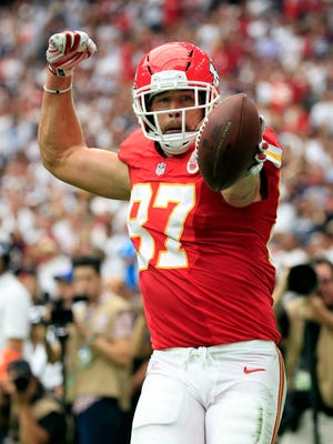 Chiefs tight end Travis Kelce reacts after catching a touchdown pass against the Houston Texans.
