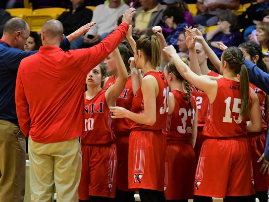 The Jim Ned girls team huddles during its 49-27 win