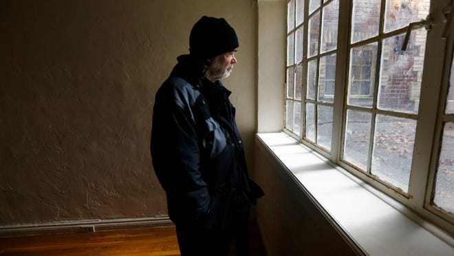 JONATHAN KOVAC HOMELESS Fri., December 5, 2014 Jonathan Kovac looks out the window of his new apartment, just after being the handed the keys moments before. He's been living for fifteen years on the streets, in and out of jail. Jonathan has mental health and alcohol issues. The Enquirer/Carrie Cochran