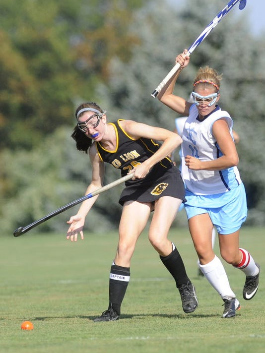 Dallastown's Taylor Kline, right, pushes past Olivia Uberti of Red Lion to get to the ball during a field hockey game in early September at Dallastown. The Wildcats won, 1-0, and remain No. 1 in our YAIAA power rankings. (DAILY RECORD/SUNDAY NEWS -- EILEEN JOYCE)