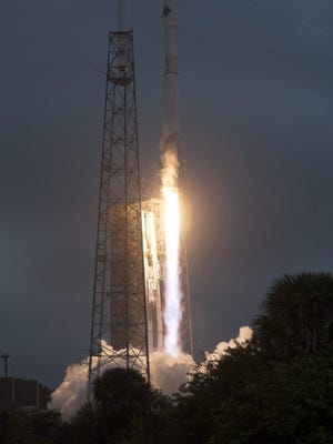 A NASA handout photo provided shows an Orbital ATK Cygnus cargo spacecraft launching aboard a United Launch Alliance Atlas V rocket on Dec. 6, 2015 at Cape Canaveral Air Force Station in Florida.