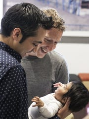 Facebook CEO and cofounder Mark Zuckerberg greets visitor