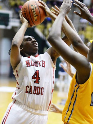 North Caddo's Jasmine Thomas tries to get the ball into the basket during the LHSAA game against Madison 