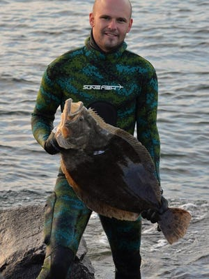 Mark Guenther, Barnegat, with a 10-pound fluke he speared with a Slingfish HD43 carbon fiber spear gun in Barnegat Inlet.