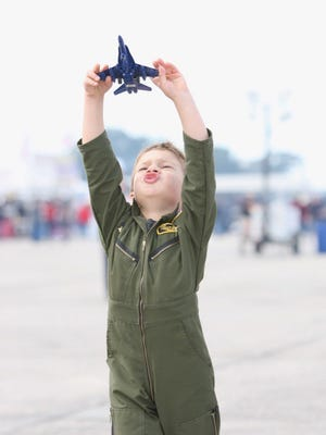 A child plays with his toy jet ahead of the Blue Angels Homecoming show Friday at Pensacola Naval Air Station.