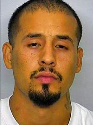 This undated photo provided by the Bismarck Police Department in Bismarck, N.D. shows Ulises Villalobos. Authorities have found the vehicle used by Villalobos who allegedly tried to run over a Bismarck police officer, but are still searching for him. Police say the officer wasn't harmed, and that the officer shot at the driver, who they identified as Villalobos. They didn't say if he or the vehicle was struck. Three schools issued shelter-in-place orders for students for about 1 ½ hours.