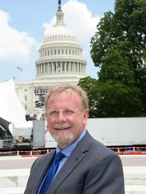 Paul Trone pictured in front of the United States Capitol building in Washington, D.C.