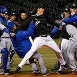 Chicago White Sox's Jeff Samardzija, center, fights with Kansas City Royals players April 23 during a benches-clearing brawl.