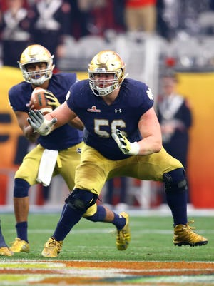 Jan 1, 2016; Glendale, AZ, USA; Notre Dame Fighting Irish offensive lineman Quenton Nelson (56) against the Ohio State Buckeyes during the 2016 Fiesta Bowl at University of Phoenix Stadium.