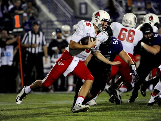 Ball State quarterback Riley Neal runs against Northwestern