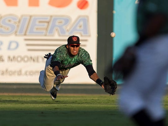 Visalia Rawhide left fielder Victor Reyes attempts to make a diving catch in Game 2 of the California League North Division Championship Series on Sunday at Recreation Park.