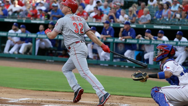 The Cincinnati Reds' Jay Bruce (32) watches his three-run home run in front of Texas Rangers catcher Robinson Chirinos during the first inning of a baseball game in Arlington, Texas, Tuesday, June 21, 2016.