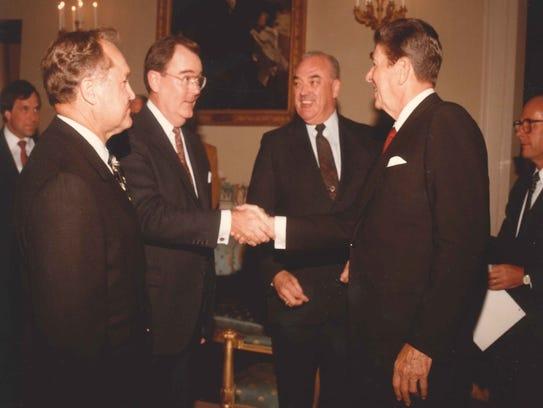 Bob Gable shakes hands with President Ronald Reagan.