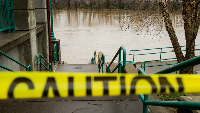 Caution tape outside McGregor Park due to flooding on February 22, 2018.