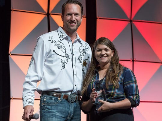 Cattle Baron's Ball committee member Ken Hopkins with award recipient Kate Mahanic.