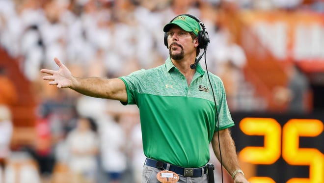 Notre Dame defensive coordinator Brian VanGorder gestures in the first quarter against the Texas Longhorns at Darrell K. Royal-Texas Memorial Stadium. Texas won 50-47 in double overtime.