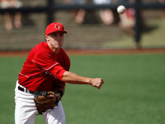 Vanderbilt's Aaron Westlake is forced out at second base as Louisville shortstop Adam Duvall throws on to first to complete a double play during the first inning of their NCAA regional college baseball game in Louisville, Ky., Sunday, June 6, 2010.  (AP Photo/Ed Reinke)