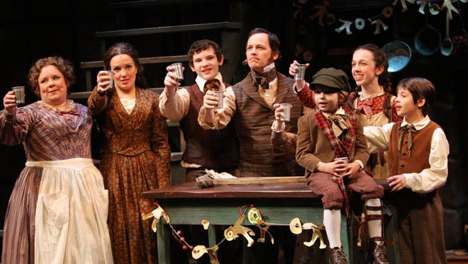 The cast of A Christmas Carol at Geva toasts everyone.
