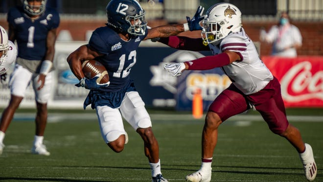 Georgia Southern senior running back Wesley Kennedy III of Savannah, shown Nov. 14 in a 40-38 win over Texas State, is a key contributor to the Eagles' offense and special teams.