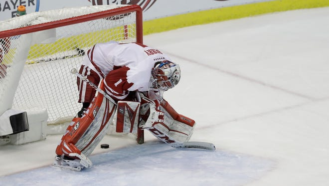 Wisconsin goalie Jack Berry stands in net after Penn State forward Liam Folkes scored the winning goal in the second overtime of the Big Ten championship game Saturday night.