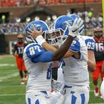MTSU quarterback Brent Stockstill (12) and Richie James (87) were named to the Maxwell Award watch list on Tuesday.